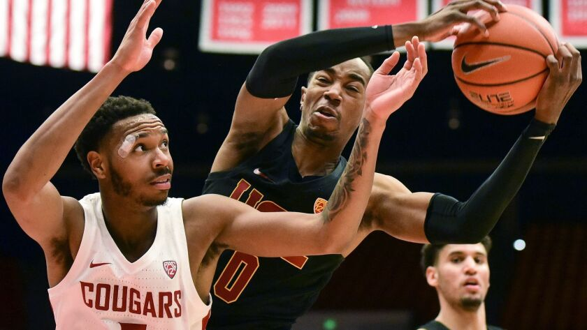 USC guard Shaqquan Aaron grabs a rebound away from Washington State forward Marvin Cannon during the second half on Saturday.