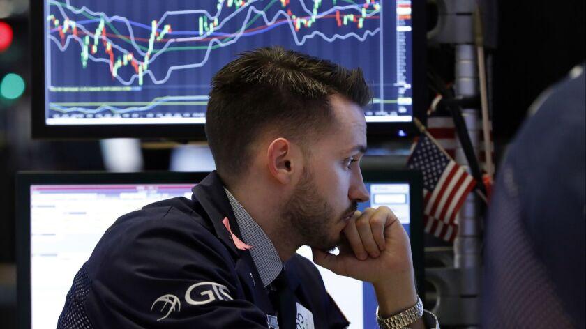 Specialist Matthew Greiner on the floor of the New York Stock Exchange.