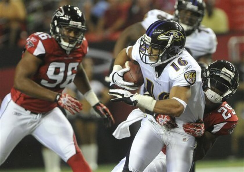 Baltimore Ravens wide receiver David Reed (16) is tackled by Atlanta Falcons defensive back Darrin Walls (29) during the first half of an NFL preseason football game on Thursday, Sept. 1, 2011, in Atlanta. (AP Photo/John Amis)