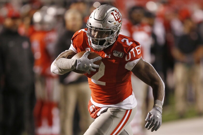 Utah running back Zack Moss carries the ball against Colorado in the second half on Saturday in Salt Lake City.
