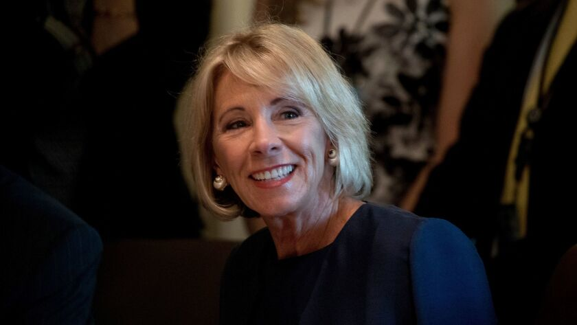 Education Secretary Betsy DeVos attends a meeting in the Cabinet Room of the White House in Washington on June 12.