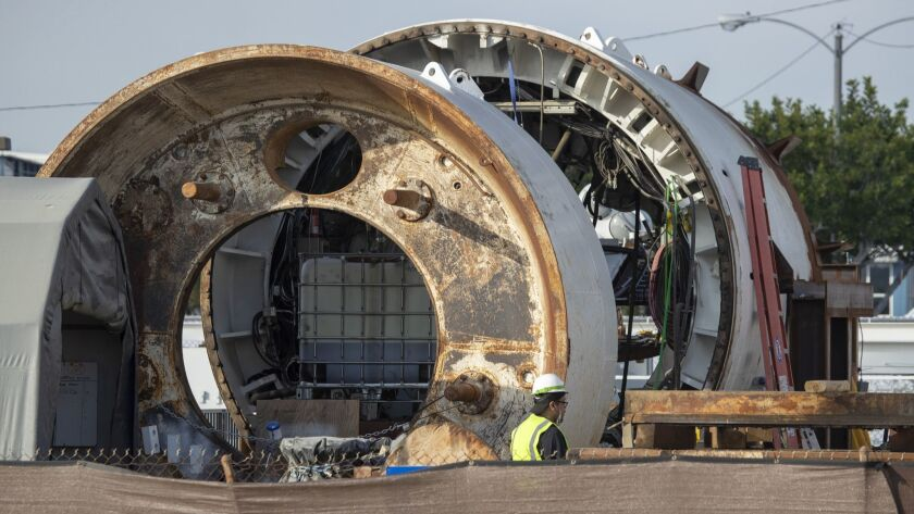 Construction crews in Hawthorne work on the entrance to a tunnel across the street from SpaceX headquarters. On Tuesday, the Boring Co. will unveil the first leg in what founder Elon Musk envisions as a vast network of tunnels to ease traffic congestion in Southern California.
