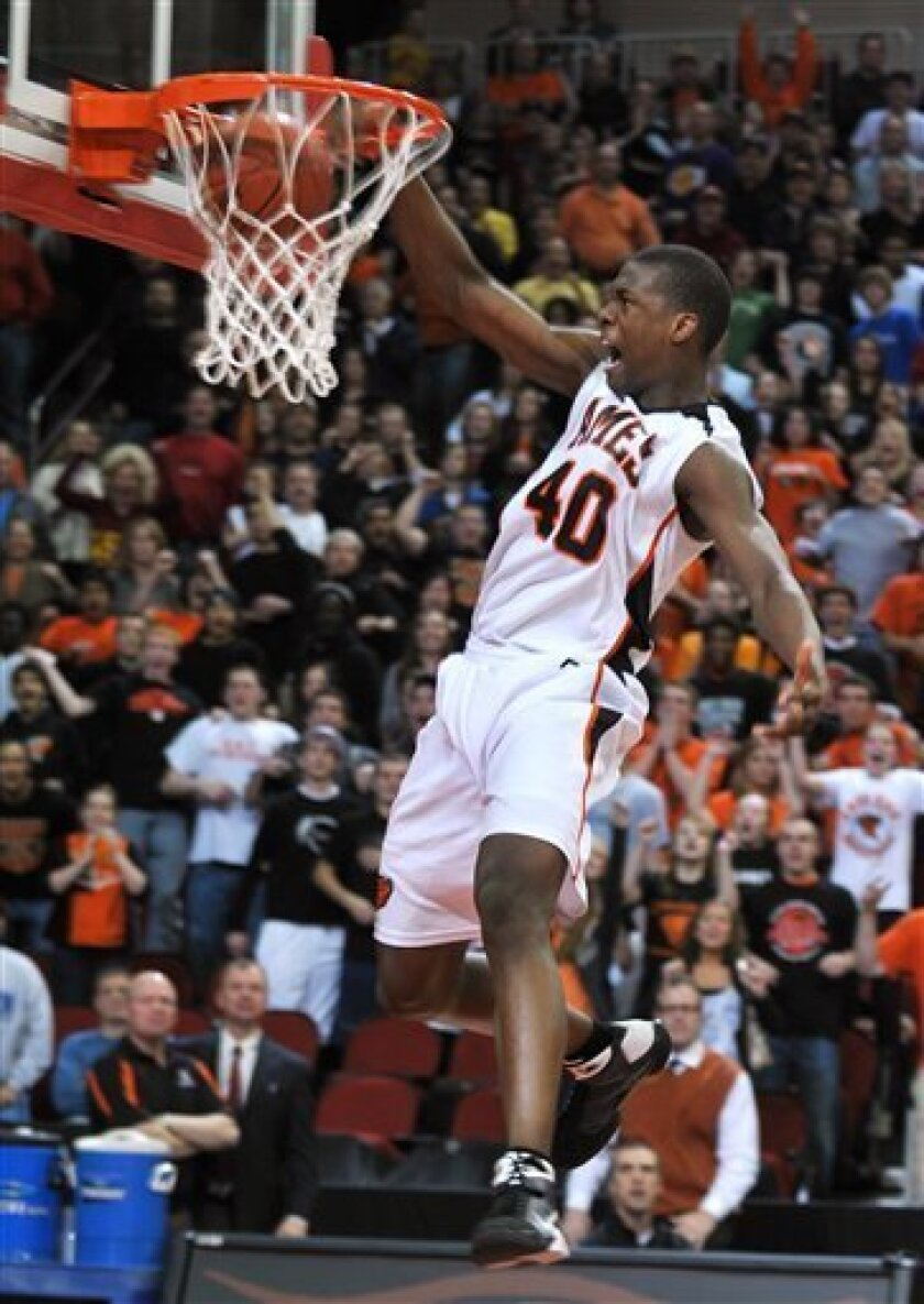 FILE - This March 14, 2009, file photo shows Ames High School's Harrison Barnes dunking the ball during the fourth quarter of the Class 4A championship game against Marion Linn-Mar, at the state basketball tournament in Des Moines, Iowa. North Carolina's Barnes became the first freshman to make the list since voting began before the 1986-87 season. (AP Photo/Steve Pope, File)