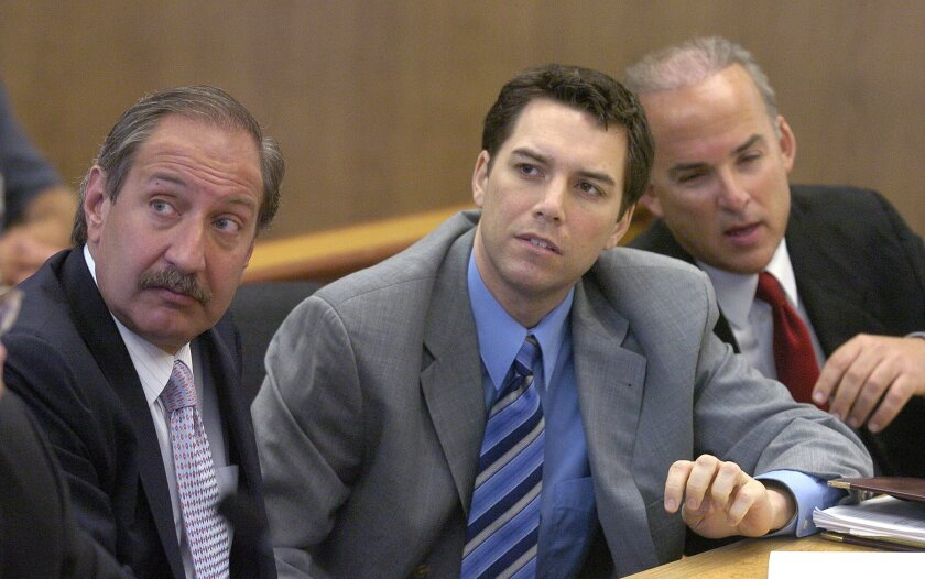FILE - In this July 29, 2004, file photo, Scott Peterson, center, with defense attorneys Mark Geragos, left, and Pat Harris listens to judge Alfred A. Delucchi in a Redwood City, Calif., courtroom. Superior Court Judge Anne-Christine Massullo said Wednesday Oct. 6, 2021, that she plans to resentence Peterson to life in prison on Dec. 8, while she separately considers whether he receives a new trial in the 2002 murders of his pregnant wife and unborn son. (Al Golub/The Modesto Bee via AP, Pool, File)