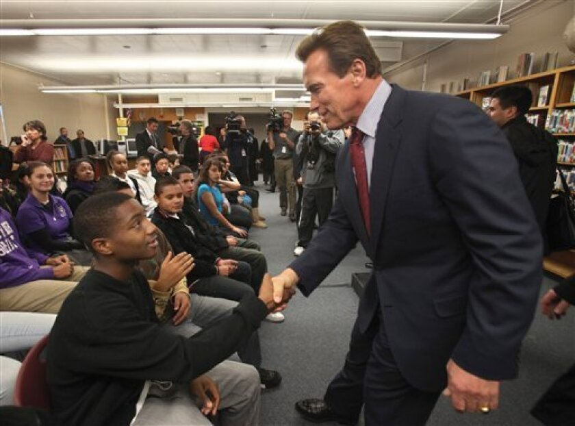 Gov. Arnold Schwarzenegger shakes hands with eighth grader Daquan Scott, 14, following his remarks at the Rosa Parks Middle School, in Sacramento, Calif., Tuesday, Jan. 5, 2010. Schwarzenegger visited the school where he called on lawmakers to approve a measure he is backing for federal Race to the Top education funding. California stands to qualify for up to $700 million. (AP Photo/Rich Pedroncelli)