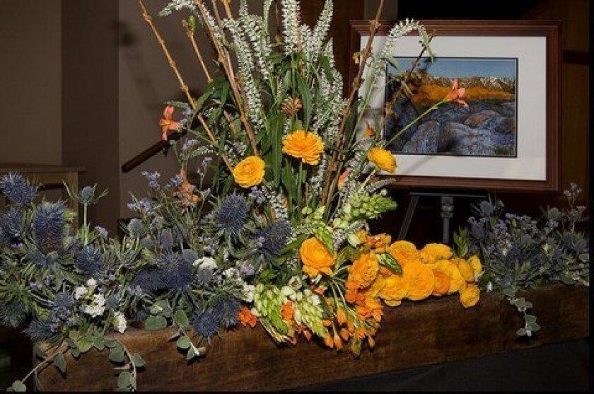 Artwork by Marilyn Barrett, floral design by Alice Harmon.