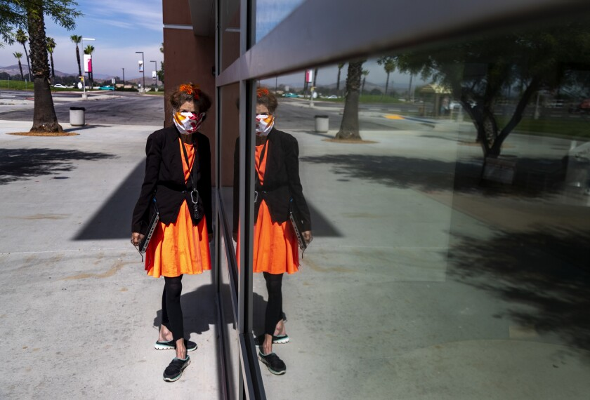 Activist Albia Miller is reflected in the glass at the Mt. San Jacinto College library