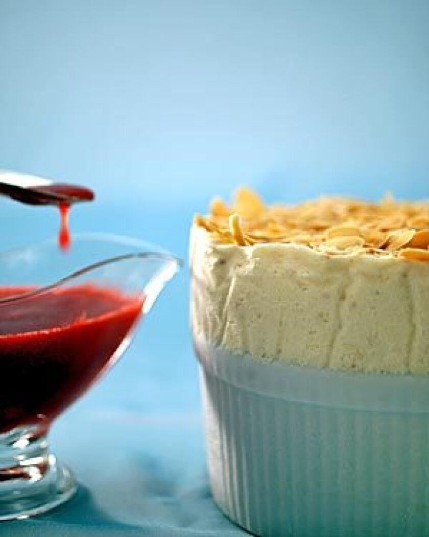 A custard base lends a creamy texture and rich flavor to frozen peach souffle with raspberry sauce