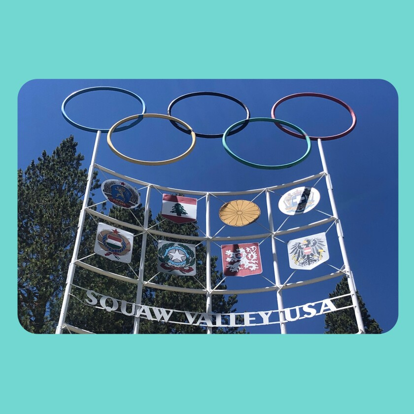 The Olympic rings stand at the entrance to a ski resort