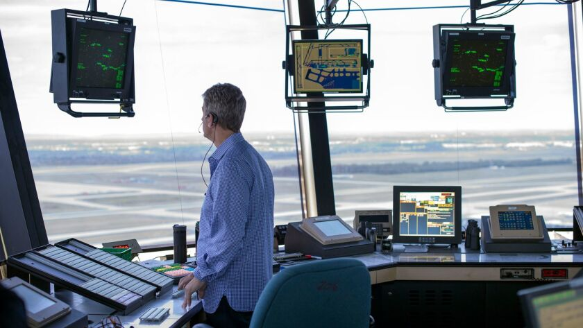 An air traffic controller works at Washington Dulles International Airport in 2016.