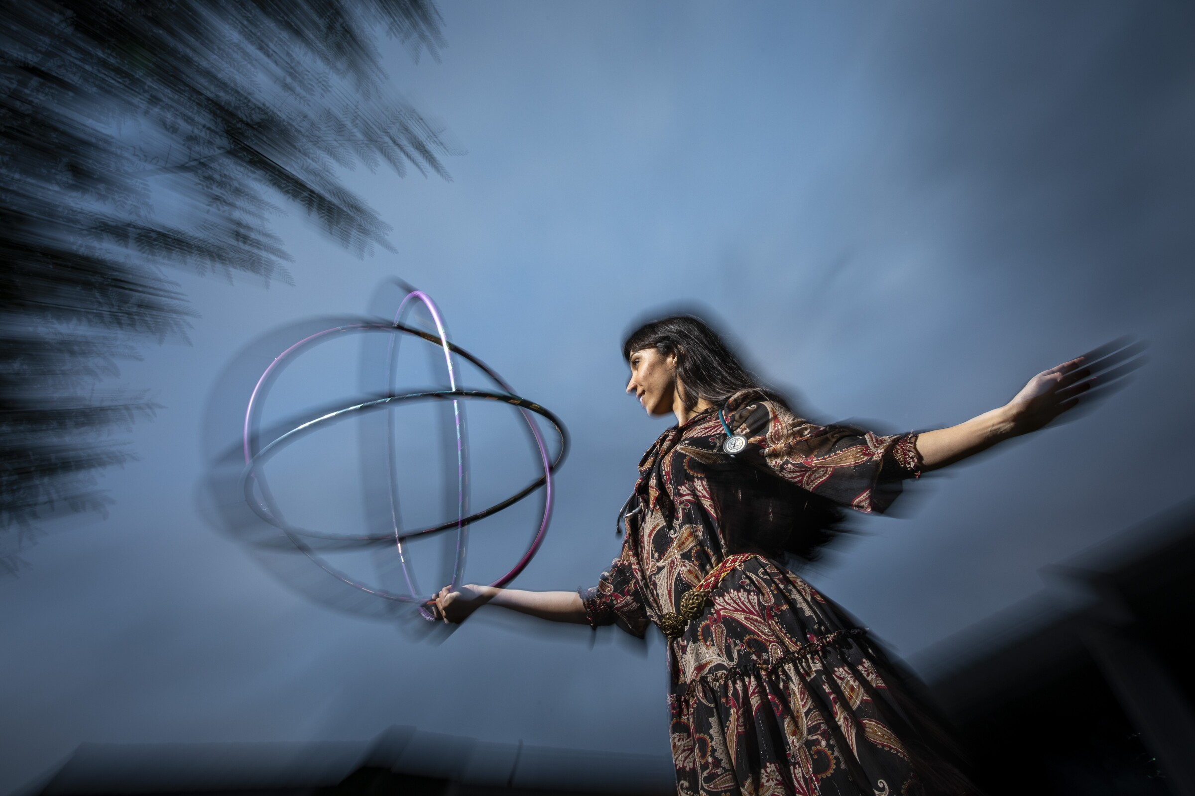 Dr. G. Sofia Nelson is pictured dancing with a hoop.