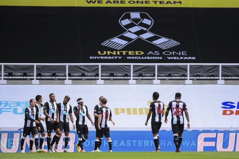 Newcastle players celebrate their third goal during the English Premier League soccer match between Newcastle United and Sheffield United at St James' Park stadium in NewCastle, England, Sunday, June 21, 2020. (Laurence Griffiths/Pool via AP)