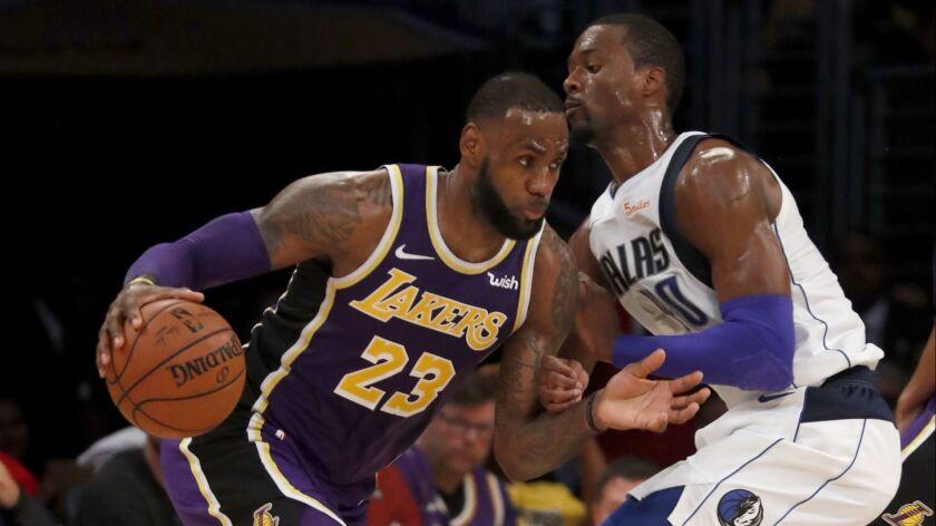 LOS ANGELES, CALIF. - OCT. 31, 2018. Lakers forward LeBron James drives to the basket against Maveri