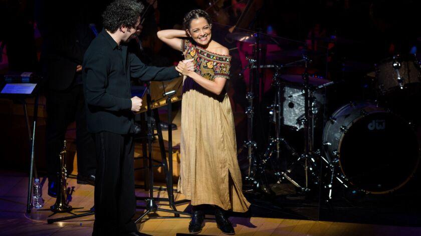 LOS ANGELES, CA - OCTOBER 12, 2017: Conductor Gustavo Dudamel greets pop singer Natalia Lafourcade o
