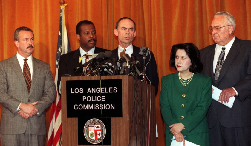 Judge Raymond Fisher at a news conference