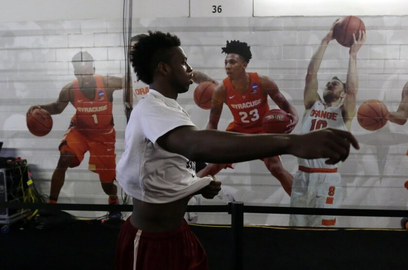 Oklahoma's Buddy Hield walks past the Syracuse locker room for a practice session for the NCAA Final Four college basketball tournament Thursday, March 31, 2016, in Houston. (AP Photo/Eric Gay)