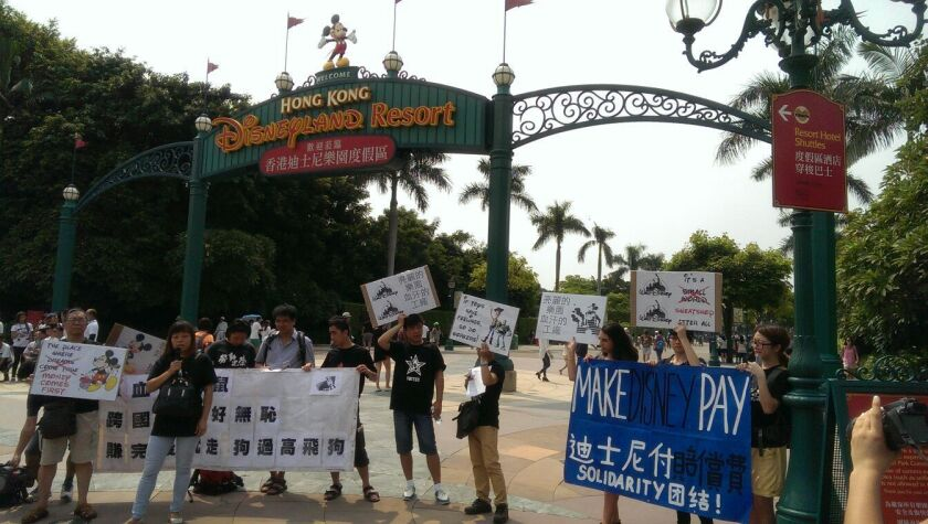 Workers from a shuttered mainland China toy factory that made items for Tokyo Disneyland protest outside the theme park last summer.