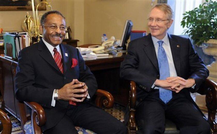 Illinois U.S. Senate Appointee Roland Burris, left, smiles as he meets with Senate Majority Leader Harry Reid of Nev., Wednesday, Jan. 7, 2009, on Capitol Hill in Washington. (AP Photo/Susan Walsh)