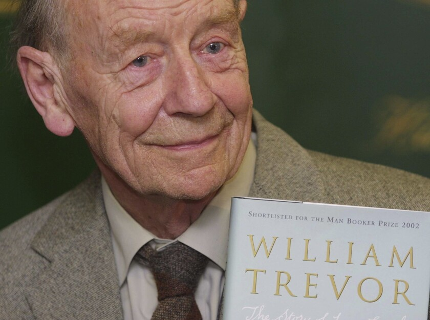 """William Trevor holds a copy of his book """"The Story of Lucy Gault"""" in 2002."""