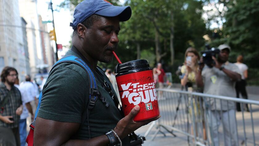 "Eric Moore attends a protest billed as the ''Million Big Gulp March"" in lower Manhattan in 2013 before a court struck down a ban on large sodas there. California is considering a similar law."