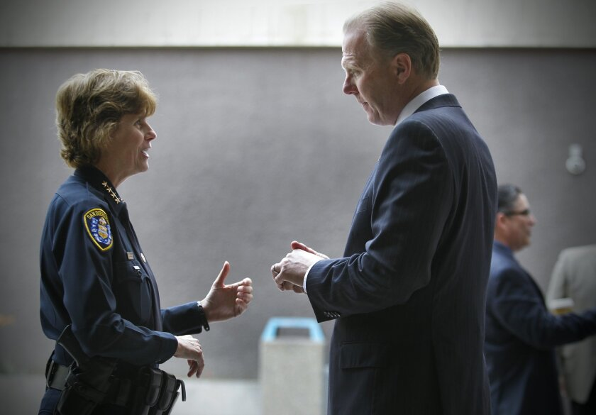 San Diego Police Chief Shelley Zimmerman, left, talks with San Diego Mayor Kevin Faulconer, at the Community Concourse.