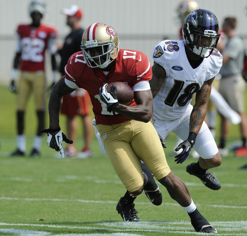 San Francisco 49ers wide receiver Chuck Jacobs catches a pass against Baltimore Ravens safety Marrio Norman in a joint football practice, Saturday, Aug. 9, 2014, in Owings Mills, Md.(AP Photo/Gail Burton)