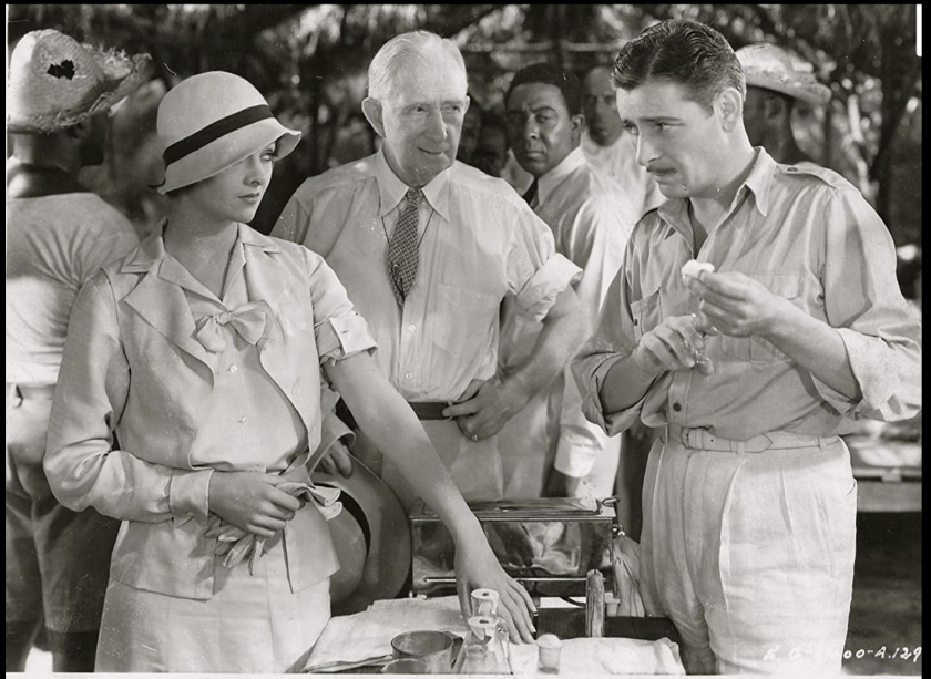 Ronald Colman, right, as Martin Arrowsmith in the 1931 film, with Myrna Loy and Alec Francis.
