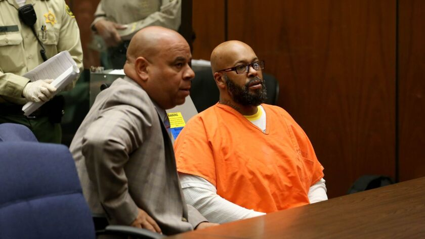 "Marion ""Suge"" Knight, right, appears in court on robbery charges in 2015 with then-attorney Matthew Fletcher, pictured next to him."