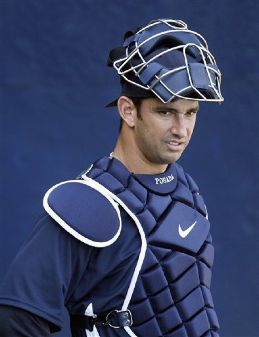 In this Feb. 15, 2008, file photo, New York Yankees catcher Jorge Posada waits his turn to catch in the bullpen during spring training baseball workouts in Tampa, Fla. On the disabled list for the second time this season, Posada had his throwing shoulder examined by New York Mets medical director Dr. David Altchek on Tuesday, July 22, 2008, and surgery was again recommended. (AP Photo/Julie Jacobson,file)