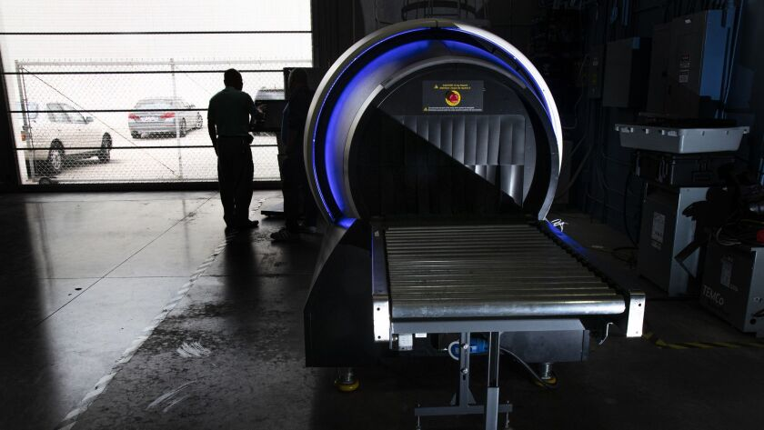 TORRANCE, CA - MAY 31, 2019: The latest 920 CT scanner by Rapiscan creates a 3-D image of contents i