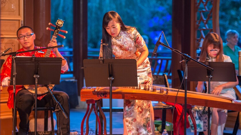 Musicians perform in the Chinese Garden at the Huntington Library, Art Collections and Botanical Gardens during its annual Harvest Moon Celebration in 2014. This year's celebration also will include traditional music.