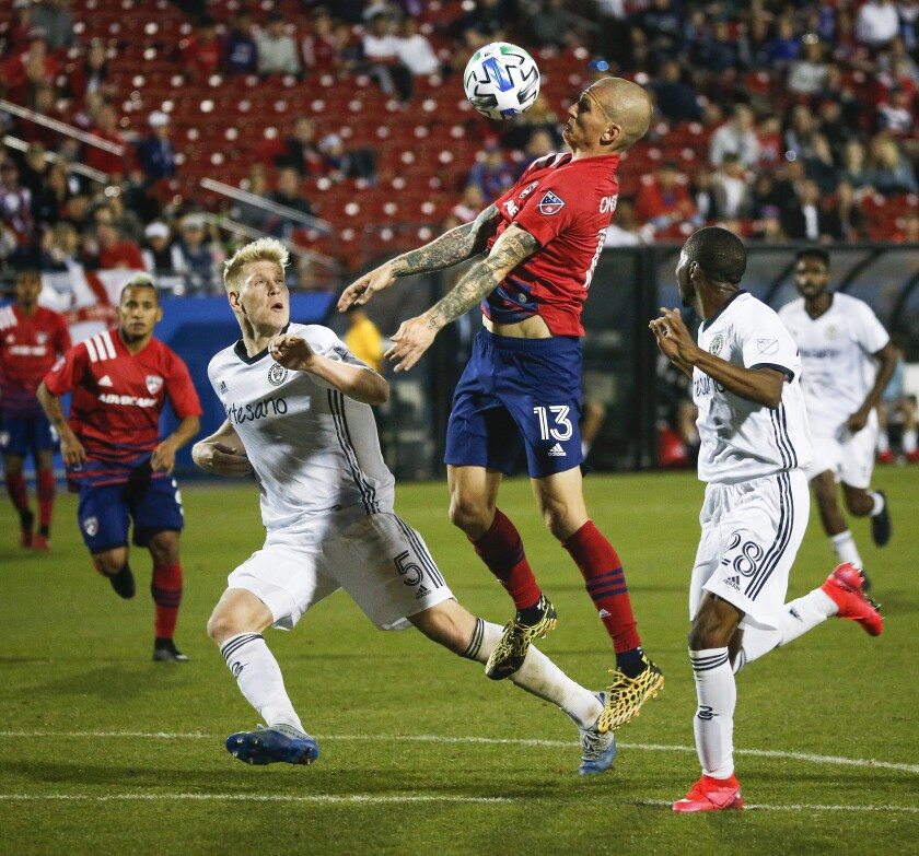 FILE-FC Dallas attacker Zdenek Ondrasek (13) receives the ball over Philadelphia Union defenders Jackob Glesnes (5) and Raymon Gaddis (28) during the second half of an MLS soccer match Saturday, Feb. 29, 2020, in Frisco, Texas. Having watched the MLS is Back tournament from afar because of coronavirus cases, FC Dallas and Nashville SC are grateful for the chance to play when they meet Wednesday, Aug, 12, 2020, for the resumption of Major League Soccer's regular season.(Ryan Michalesko/The Dallas Morning News via AP, File)/The Dallas Morning News via AP)