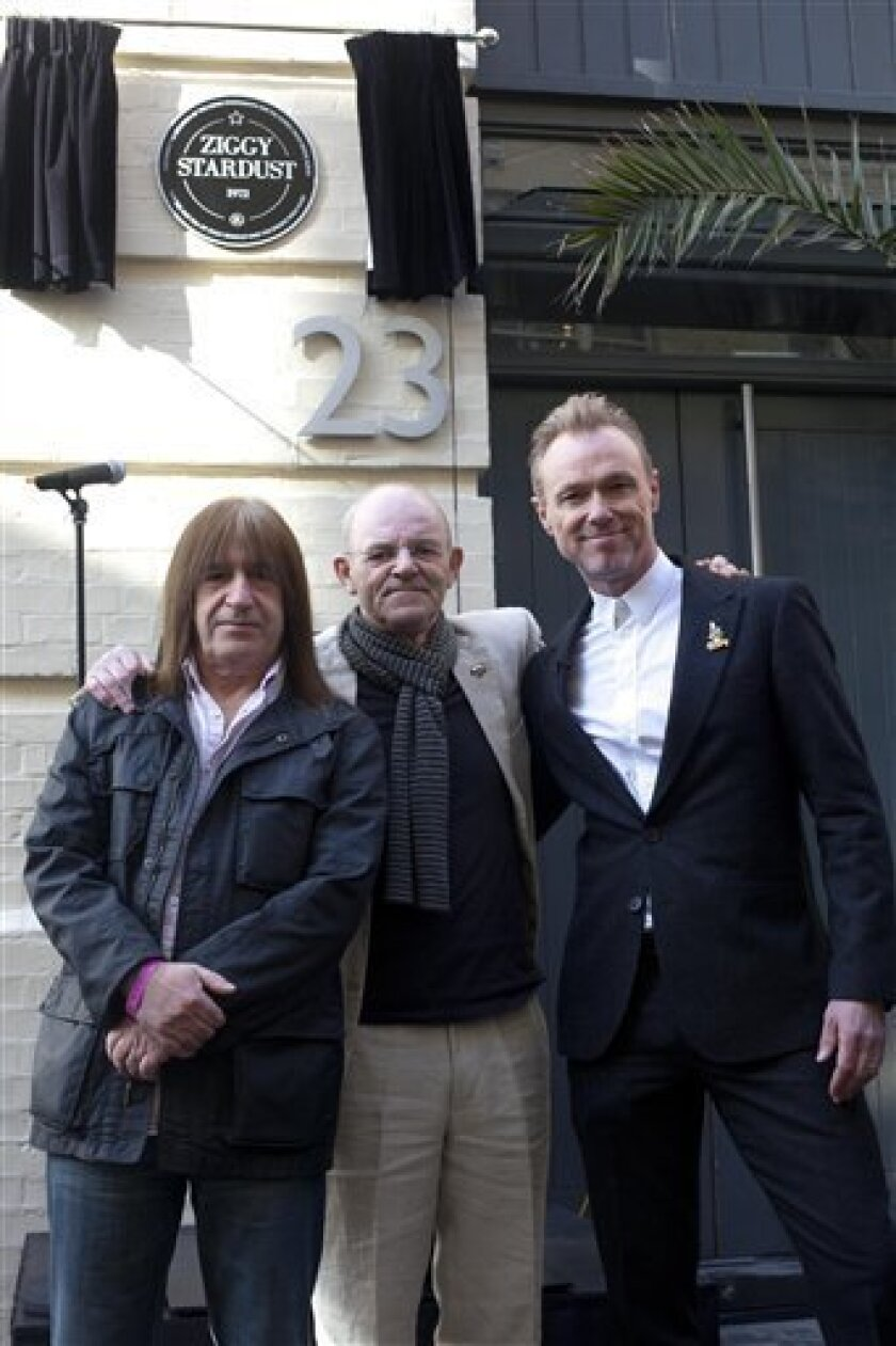 "Trevor Bolder, left and Mick Woodmansey, center, members of the Spiders from Mars and Spandau Ballet band member Gary Kemp unveil a commemorative plaque to David Bowie's iconic creation, Ziggy Stardust, in Heddon Street, London, Tuesday March 27, 2012 to mark the 40th anniversary of the album ""The Rise and Fall of Ziggy Stardust and The Spiders from Mars."" The album cover was shot in Hedden Street. (AP Photo/ David Parry/PA) UNITED KINGDOM OUT NO SALES NO ARCHIVE"