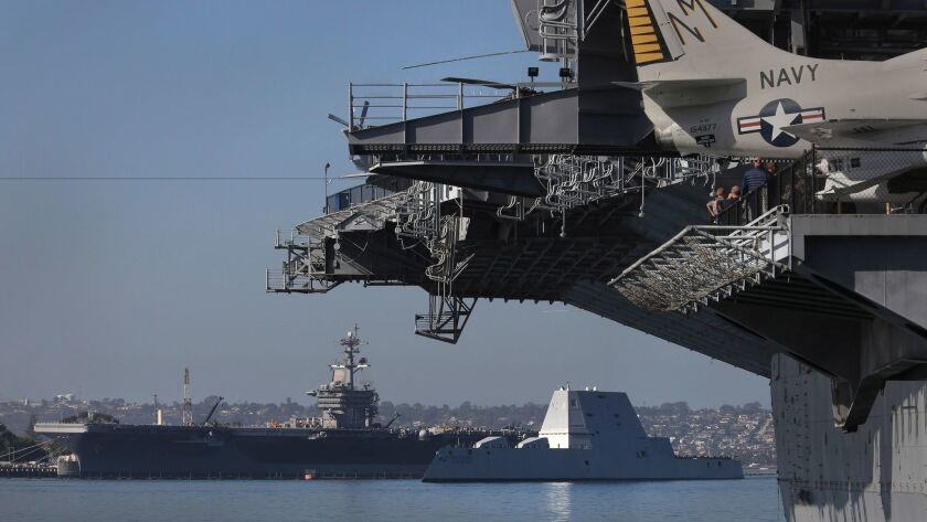 The USS Zumwalt, center right, is escorted into San Diego Bay Thursday morning, Dec. 8, 2016.