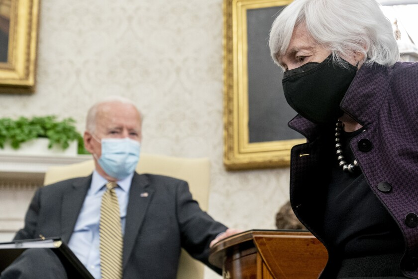 President Joe Biden, accompanied by Treasury Secretary Janet Yellen, right, speaks as he gets his weekly economic briefing in the Oval Office of the White House, Friday, April 9, 2021, in Washington. (AP Photo/Andrew Harnik)