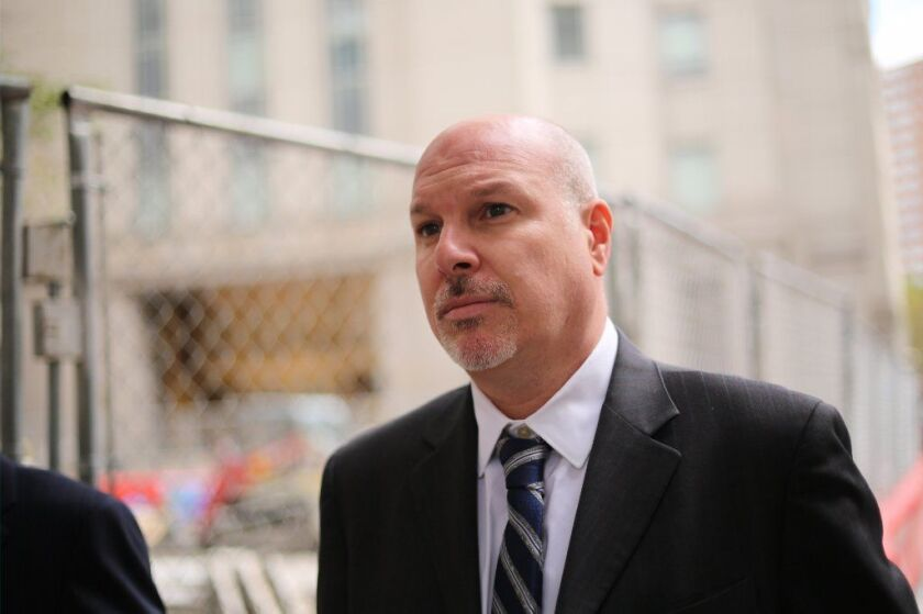 James Gatto is seen walking away from Manhattan Federal Court after an appearance on Oct. 12, 2017.