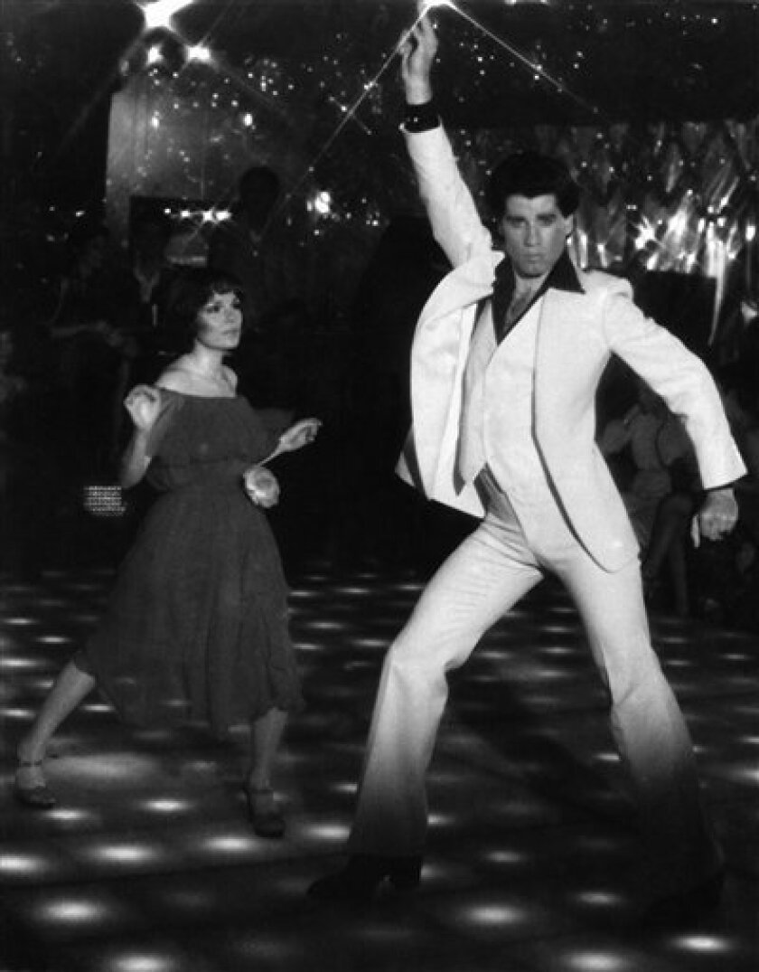 """FILE- This is a file photo of John Travolta and Karen Gorney dance in a nightclub scene to disco music in Paramount Pictures 1977 film """"Saturday Night Fever"""", which explores the restless generation growing up in the 70's. John Travolta was onto something. Women are most attracted to male dancers who have big, flamboyant moves similar to the actor's trademark style, British scientists say in a new study. (AP Photo/HO, File)"""