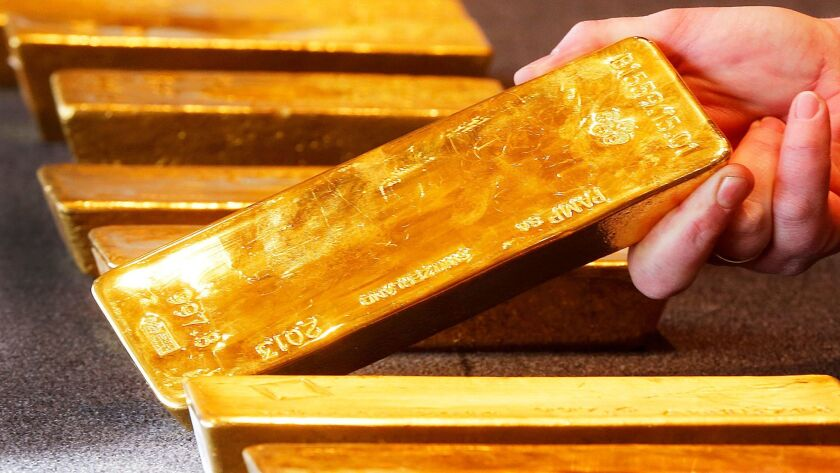 FILE - In this Feb. 9, 2017 file photo various gold bars are on display at the Bundesbank headquar