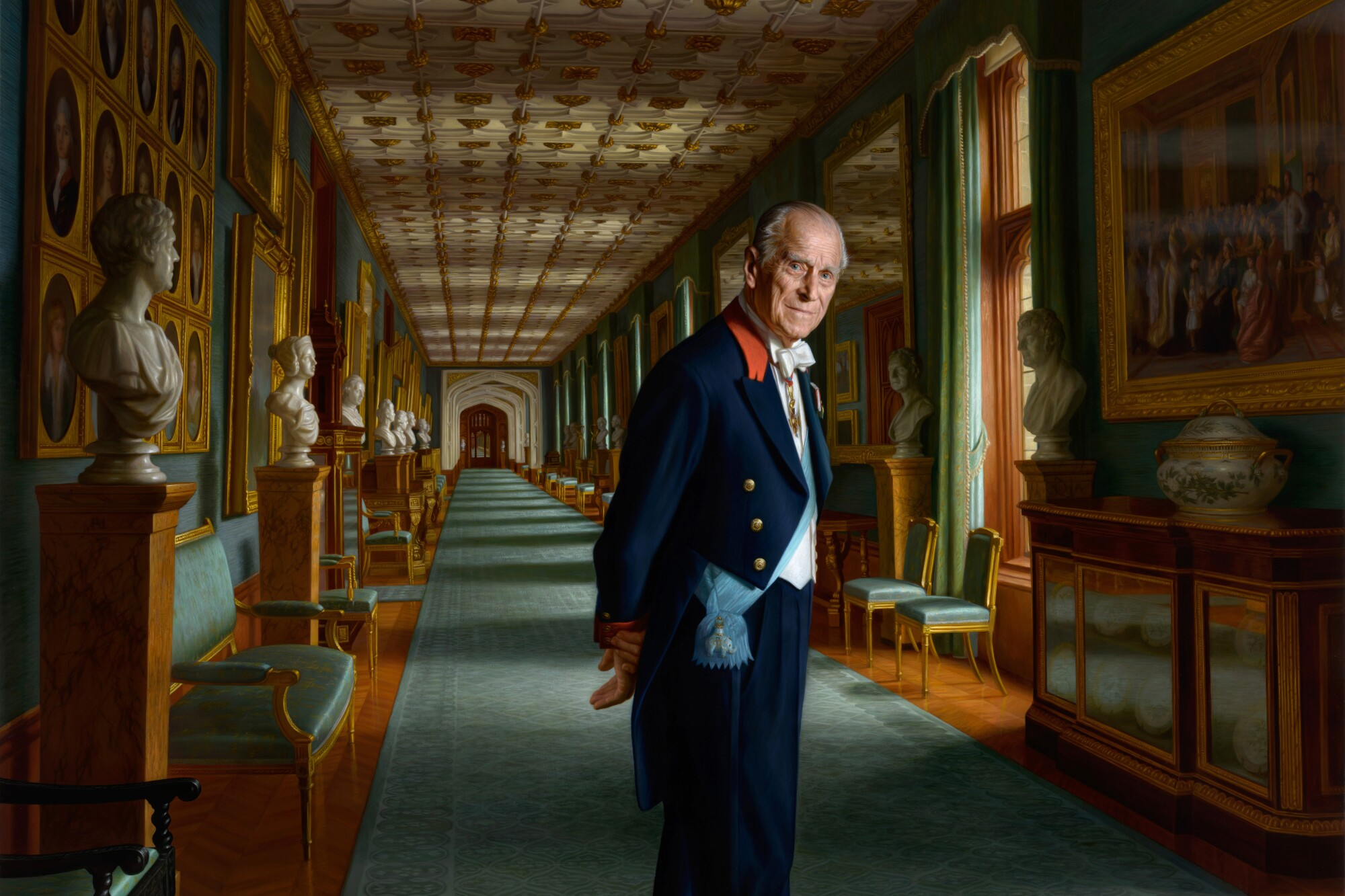 A painting of Prince Philip shows him in a royal sash with hands behind his back.