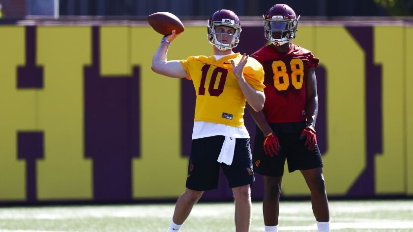 LOS ANGELES, CALIF. - AUGUST 03: USC Trojans linebacker Jack Sears (10) passes during drills as the