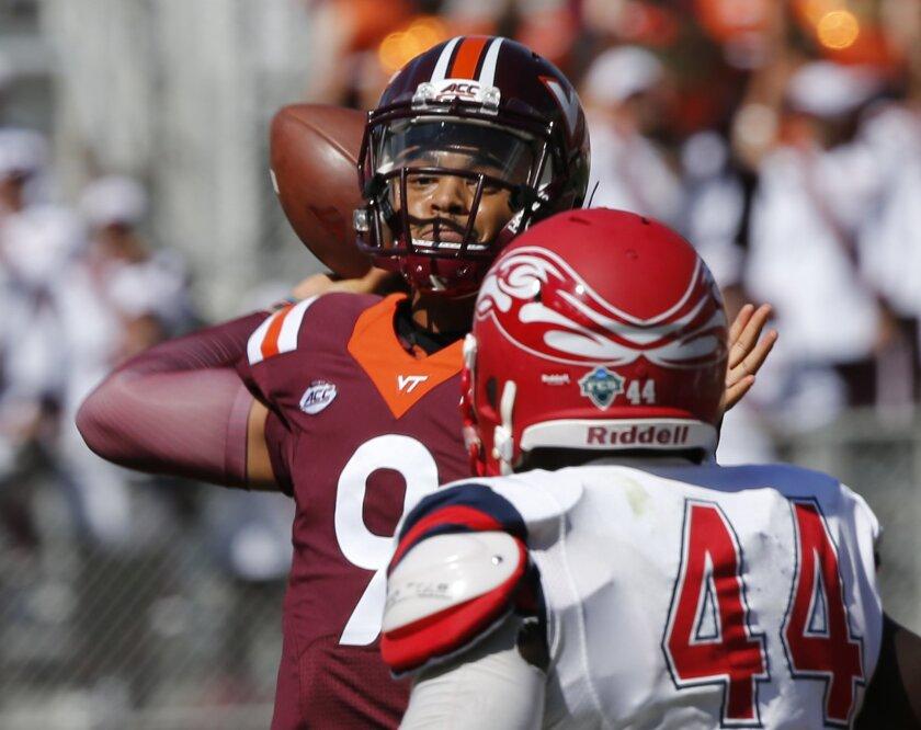 Virginia Tech quarterback Brenden Motley (9) makes a toss in front of Liberty defensive end Dia'Vante Brown (44) during the second half of an NCAA college football game in Blacksburg, Va., Saturday, Sept. 3, 2016. Virginia Tech defeated Liberty 36-13. (AP Photo/Steve Helber)