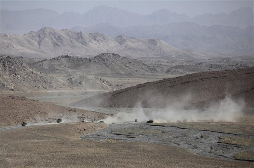 In this May 20, 2010 photo, U.S. Army Stryker vehicles kick up dust as they roll across a rocky road to pick up troops from Charlie Company, 1st Battalion, 17th Infantry Regiment of the 5th Stryker Brigade who were on patrol in the Shah Wali Kot district of Afghanistan's Kandahar province. Twenty-two men in the U.S. Army's 1st Battalion, 17th Infantry Regiment of 800 died in a yearlong Afghan tour ending this summer. Most were killed last year in the Arghandab, a gateway to the southern city of Kandahar. About 70 were injured, all but two in bomb blasts. (AP Photo/Julie Jacobson)