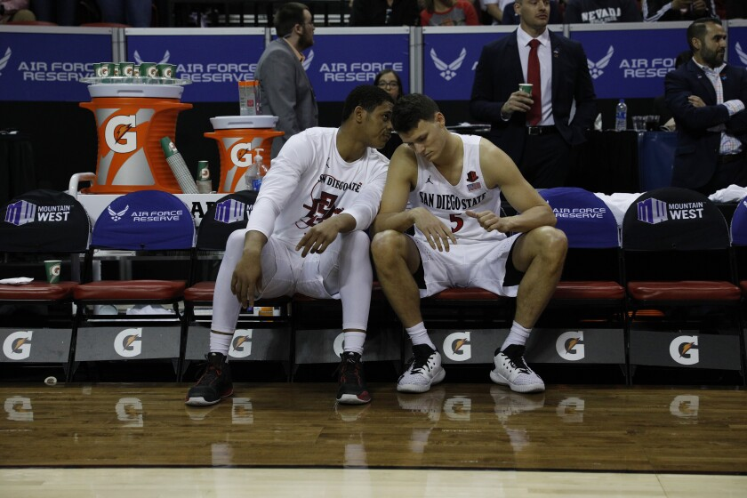 Matt Mitchell (left), Yanni Wetzell and their Aztecs teammates, whose season ended at a glossy 30-2, have to deal with not knowing just what might have been.