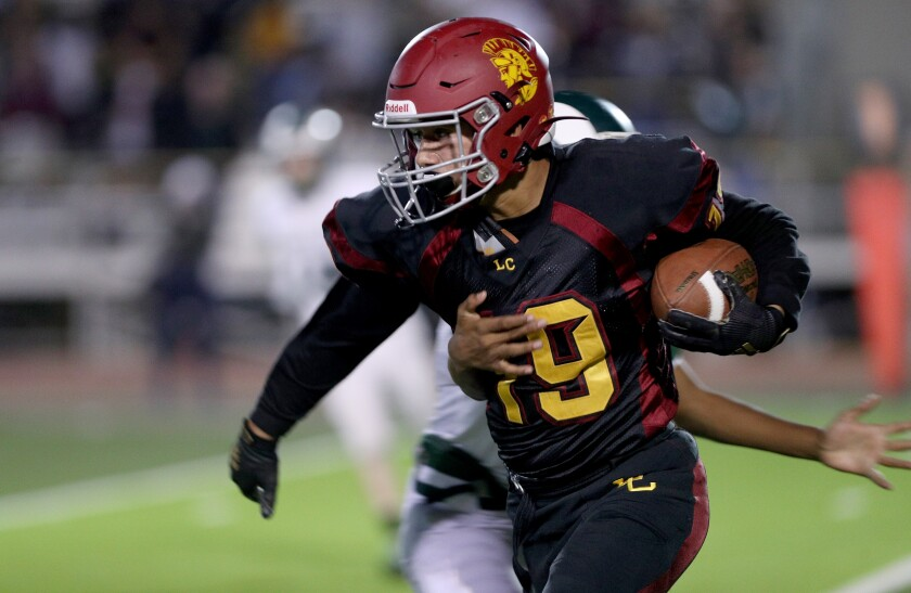 La Canada High's Justin Zoltzman caught a pass for a 22-yard gain in the first quarter of the Spartans' game against Monrovia on Friday.