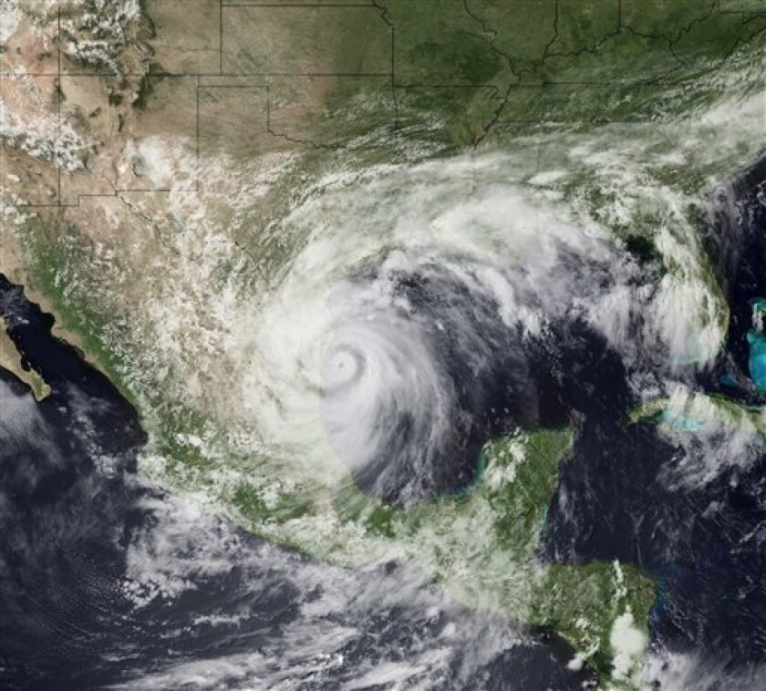 This satellite image provided by NOAA shows Hurricane Alex as it comes ashore on a relatively unpopulated stretch of coast in Mexico's northern Tamaulipas state about 110 miles south of Brownsville Texas Wednesday June 30, 2010. Alex is moving west near 10 mph maximun sustained winds are near 100 mph with higher gusts. Steady weakening is expected as the hurricane moves over land according to forecasters. (AP Photo/NOAA)