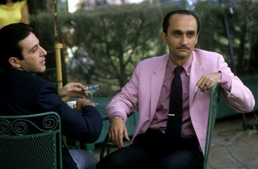 In this image released by HBO, actor John Cazale, right, is shown with Al Pacino. (AP Photo/HBO, Steve Schapiro)