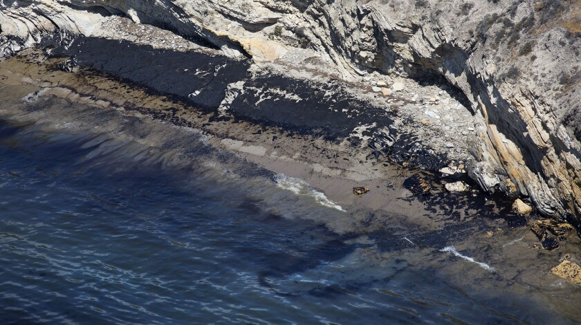 Oil stains on the shore near Refugio State Beach near Santa Barbara. A fisherman has filed suit against the operator of the pipe that burst in May.