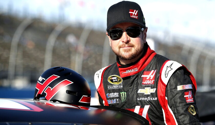 Kurt Busch gets ready to qualify for Sunday's NASCAR Sprint Cup Series auto race on Friday in Avondale, Ariz.