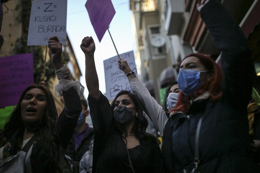 Protesters chant slogans during a rally to mark International Women's Day in Istanbul, Monday, March 8, 2021.Thousands of people joined the march to denounce violence against women in Turkey, where more than 400 women were killed last year. The demonstrators are demanding strong measures to stop attacks on women by former partners or family members as well as government commitment to a European treaty on combatting violence against women. (AP Photo/Emrah Gurel)