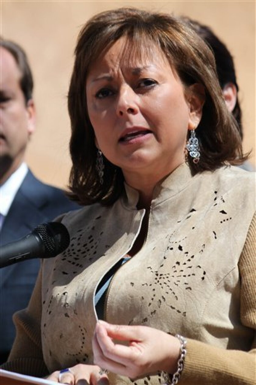 FILE - This March 19, 2011 file photo shows Gov. Susana Martinez speaking at a news conference at Wood Gormley Elementary School in Santa Fe, N.M. Martinez, under fire by immigrants rights groups for her attempts to repeal a law that lets illegal immigrants get driver's licenses, admitted in a interview with Univision that her grandparents were illegal. (AP Photo/Susan Montoya Bryan, File)